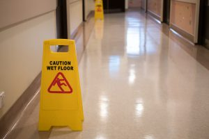 Premises Liability Law Sign Showing Warning Of Caution In Hospital Corridor